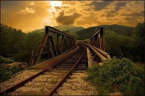 train tracks to trestle bridge  a poemdavid jonsen