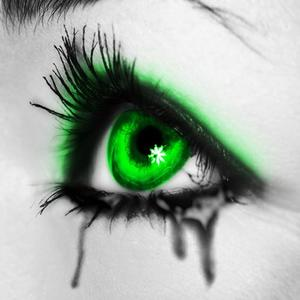 Картинка с зеленым глазом со слезой